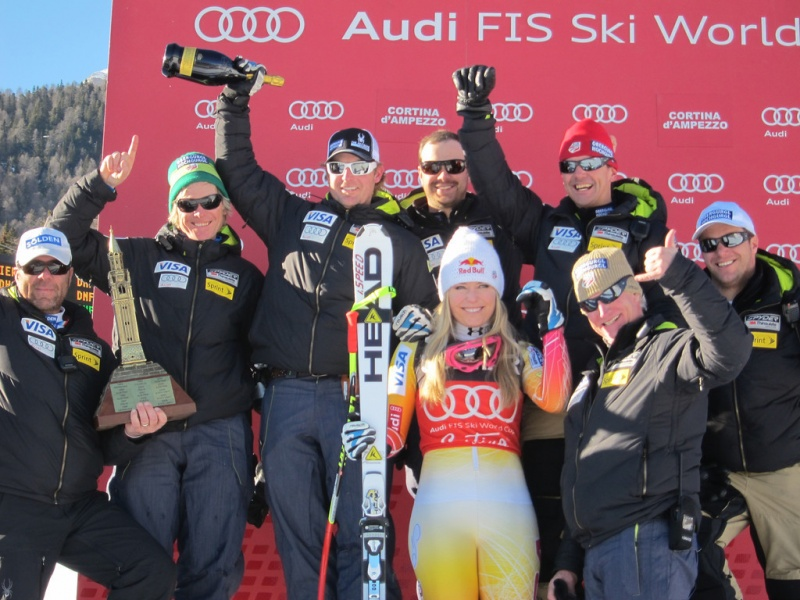 Lindsey Vonn and the U.S. Ski Team coaching staff celebrate after winning the Cortina Trophy for the most successful nation over this weekend's two-race series (photo: Doug Haney/U.S. Ski Team)