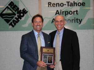 Squaw Valley President and CEO Andy Wirth, left, receives a distinguished service award on Thursday from past Reno-Tahoe Airport Board Chair John Wagnon. (photo: Squaw Valley)