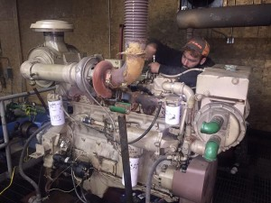 Crews work to repair a seized diesel snowmaking compressor engine as part of Tenney Mountain's rebirth. (photo: Tenney Mountain Facebook)
