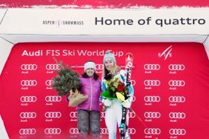 Tamara McKinney, the last American woman to win slalom in Aspen in 1981, poses on the podium with Saturday's winner, Mikaela Shiffrin. (photo: Sarah Brunson/U.S. Ski Team)