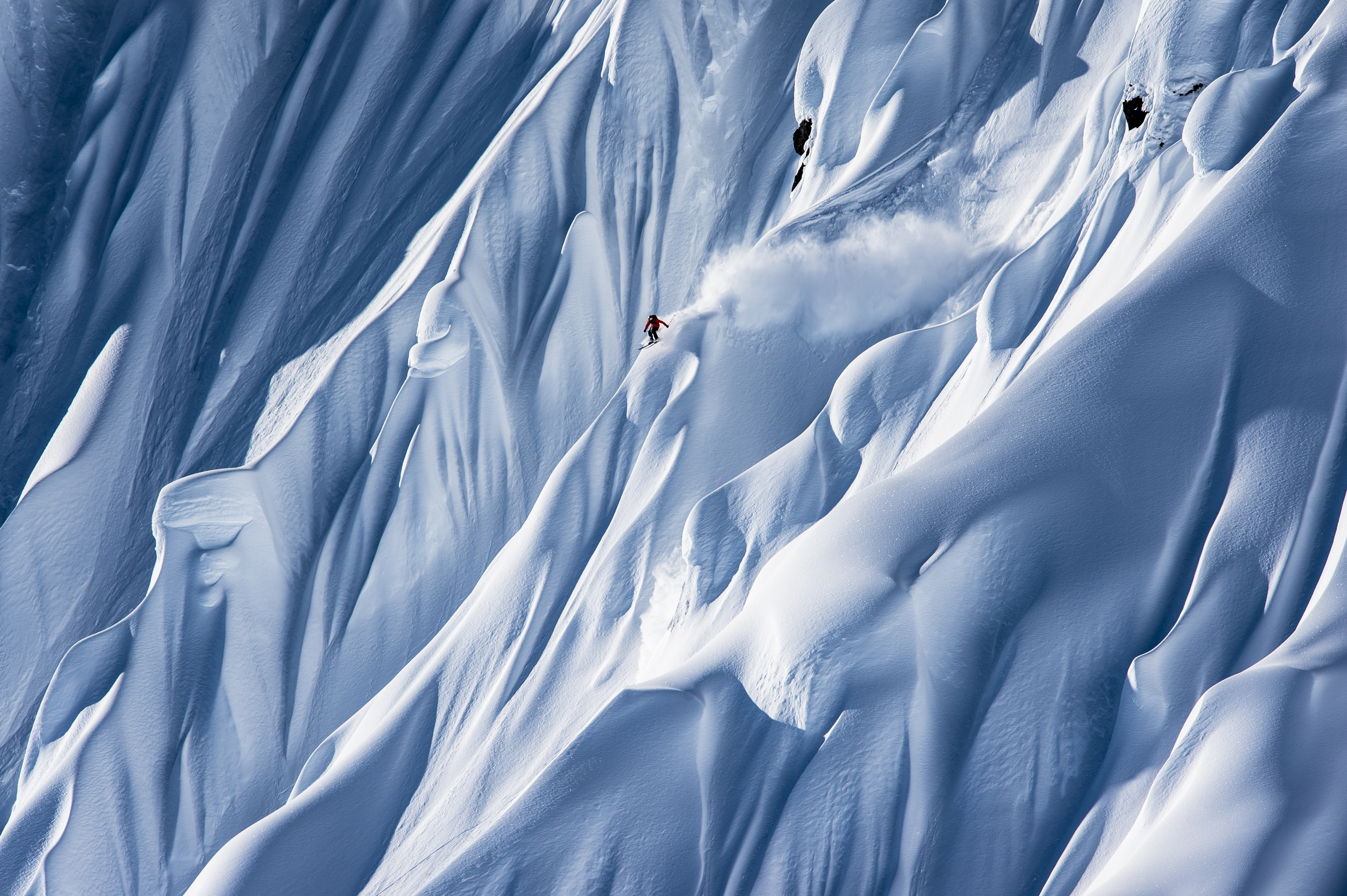 Alaska's maritime snowpack allows heli-skiers to descend much steeper lines than would be available in interior locations. (file photo: Red Bull Media House)