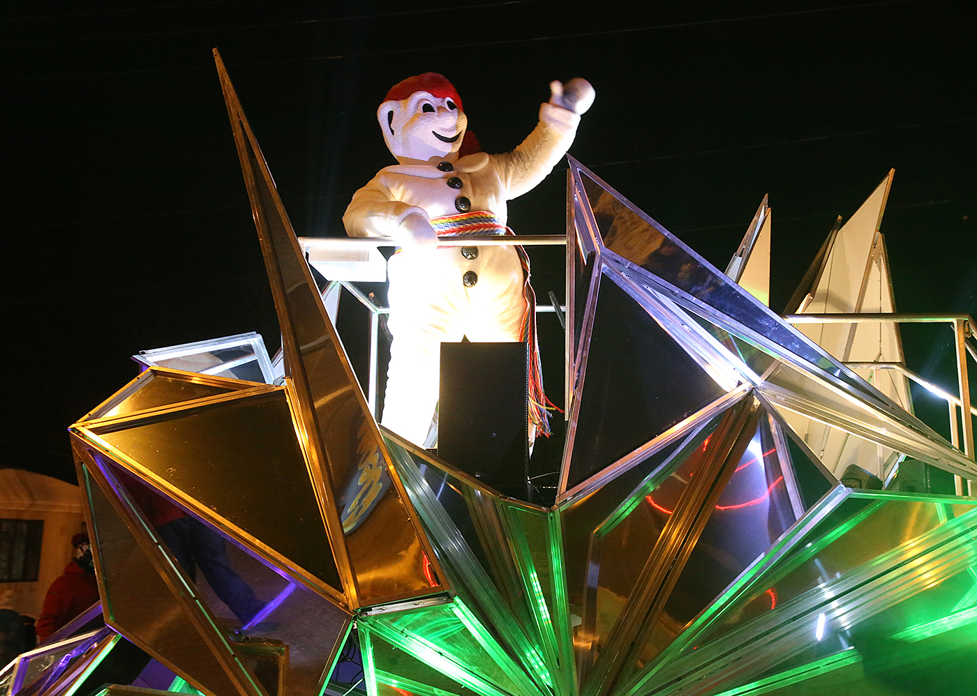 Bonhomme, the loveable mascot of the Québec City Winter Carnival rides in the last float during the 2015 nighttime parade in Charlesbourg. (Photo: FTO/Martin Griff)