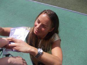 Ski racer Tina Maze signs autographs for fans at Stadion Ljudski vrt in Maribor, Slovenia, in 2015. (file photo: Janezdrilc)