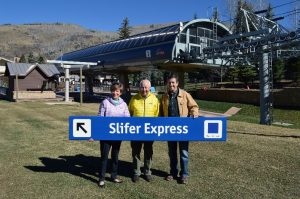 Beth and Rod Slifer receive the Slifer Express trail sign from Chris Jarnot. (photo: Vail Resorts)