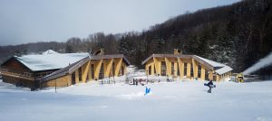 A snowboarder walks from the lodge to the lift at Canaan Valley Resort in Davis, WV. (FTO photo: Martin Griff)