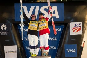 Australia's Britteny Cox, and Mikael Kingsbury of Canada celebrate dual moguls victories at Deer Valley Resort in Utah on Saturday night. (photo: Steven Earl)