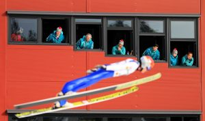 Judges watch a Nordic Combined athlete take part in Ski Jump training ahead of the FIS Nordic World Ski Championships in Lahti, Finland. (photo: Getty Images/Richard Heathcote via USSA)