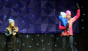 Kikkan Randall and baby Breck celebrate World Championships medal. (photo: Tom Kelly)